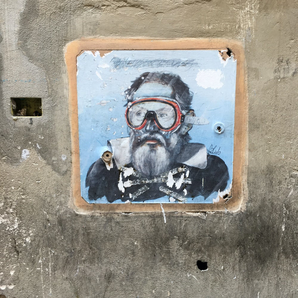 man wearing red goggles artwork