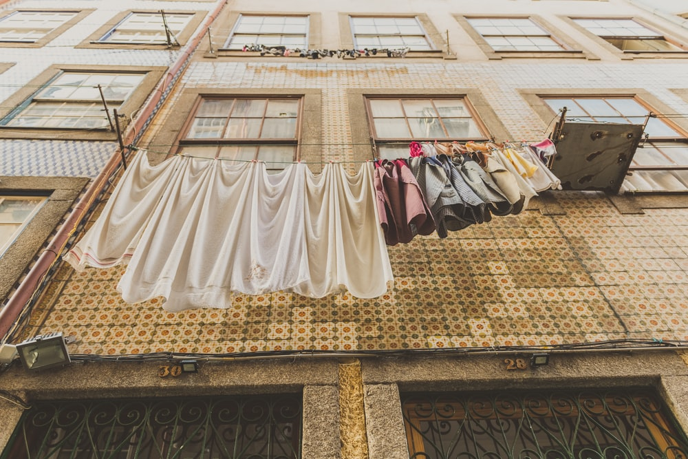 assorted clothes hanged on wire