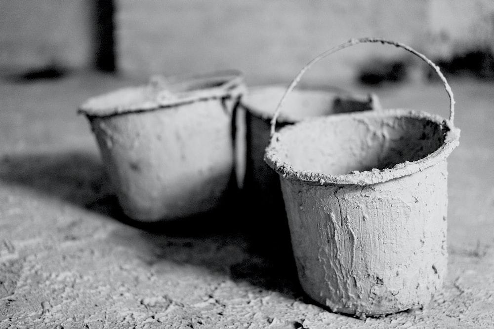 three gray buckets