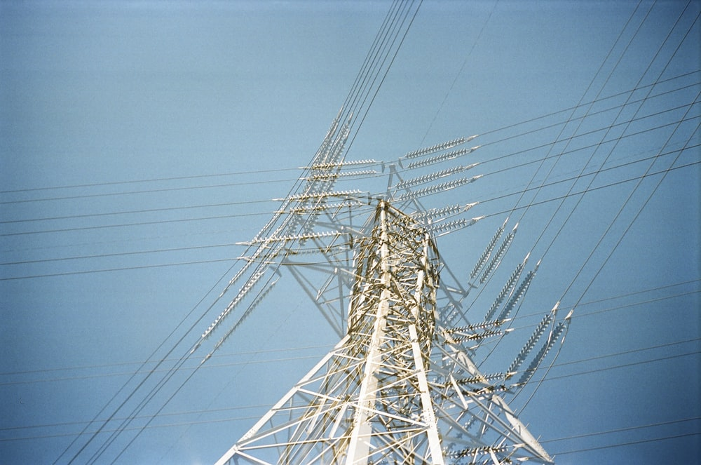 low angle photo of transmission network post