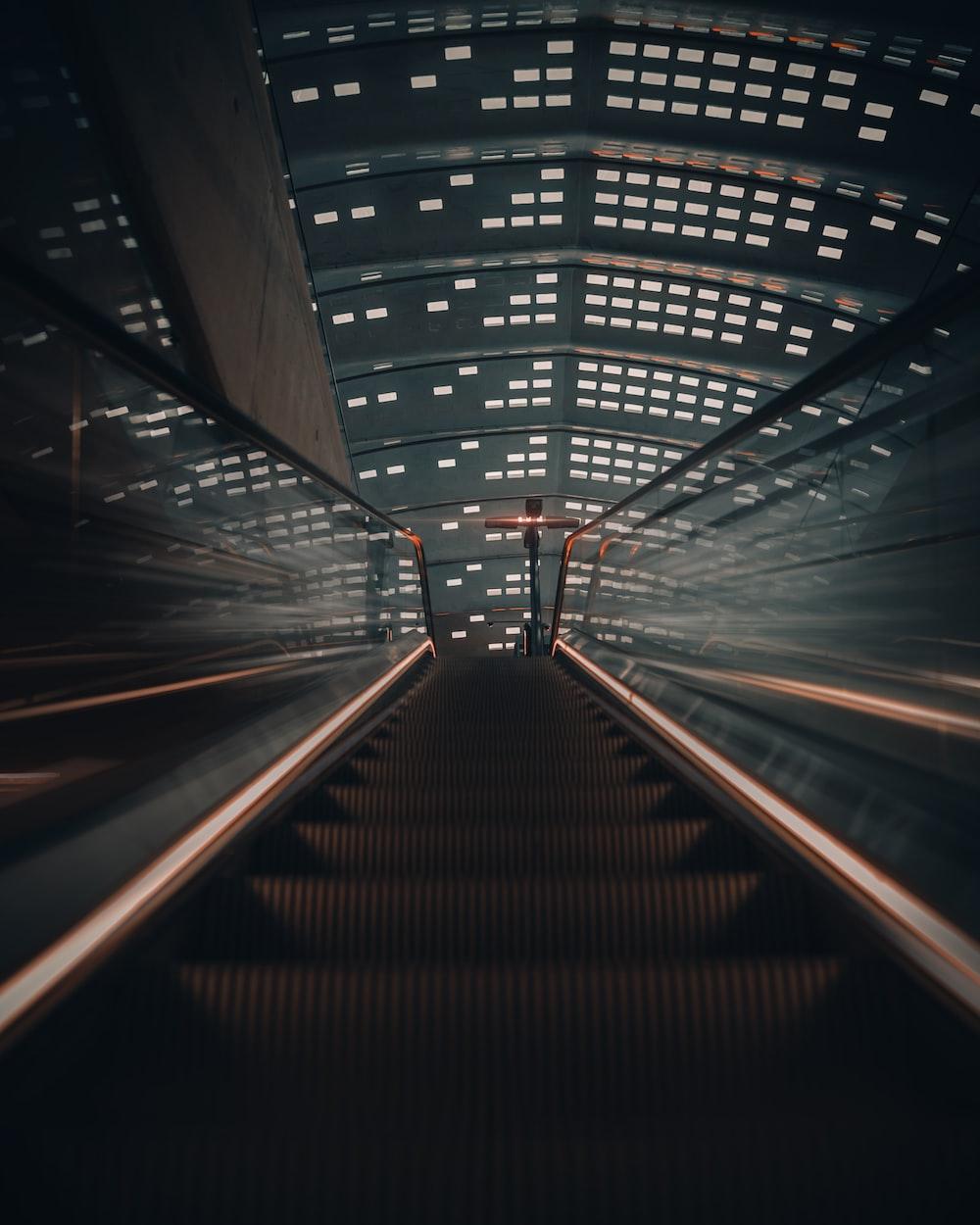 gray and white escalator
