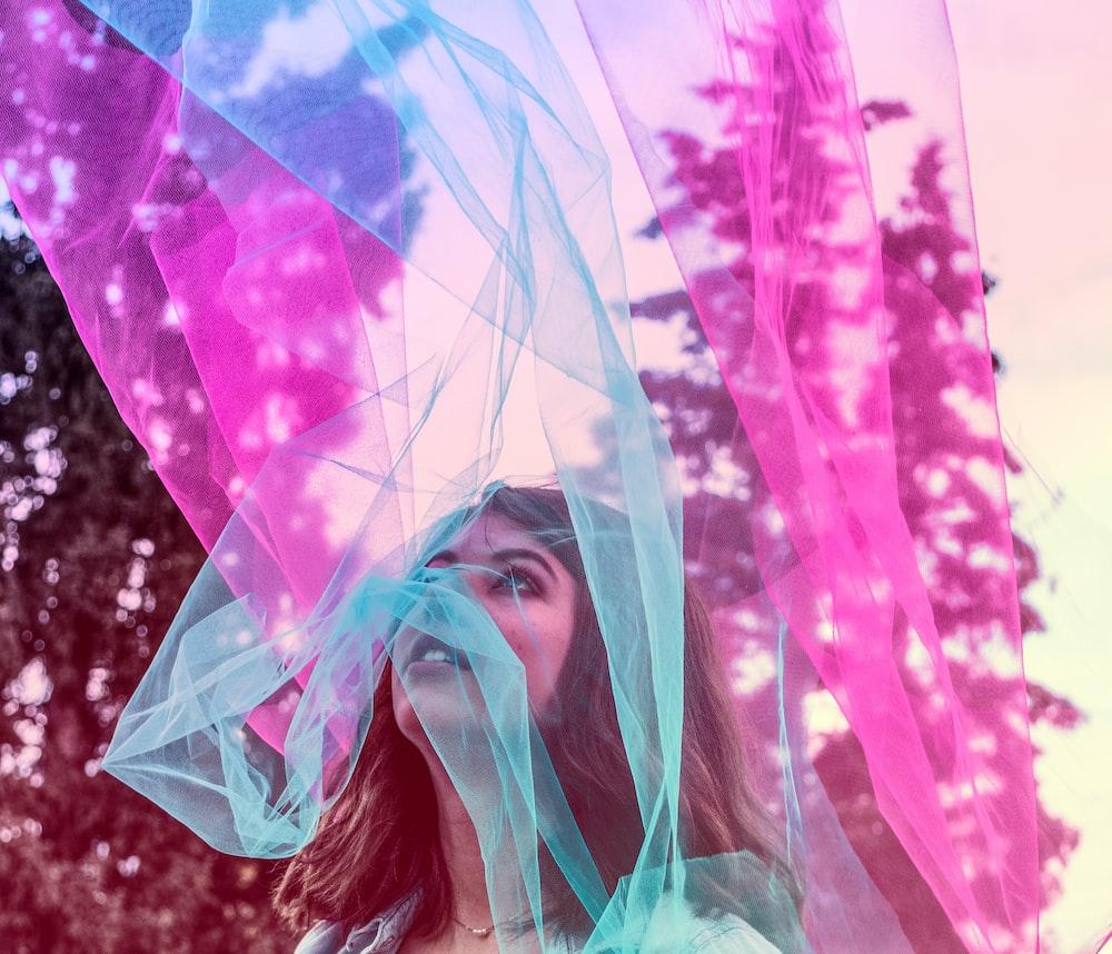 tealand purple mesh textile behind of portrait woman
