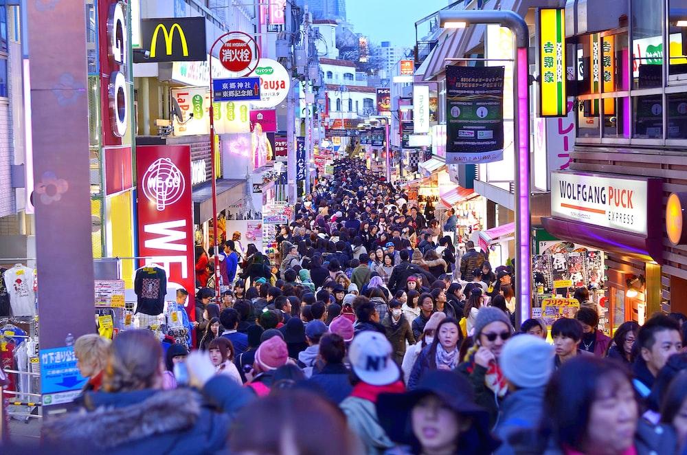 crowd between buildings