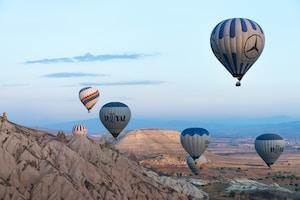 white hot air balloon lot near mountain