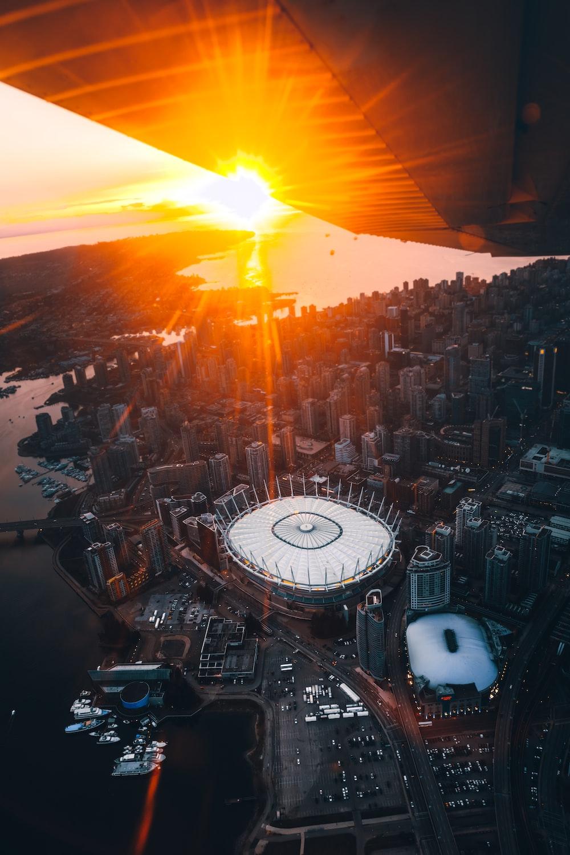 aerial photo of city beside sea