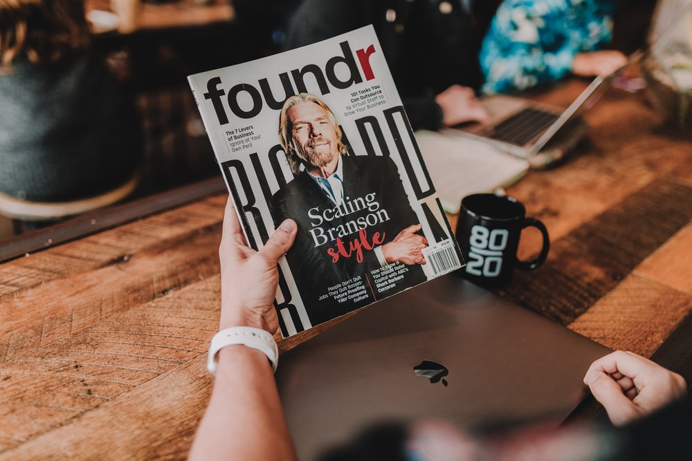 person holding Foundr book