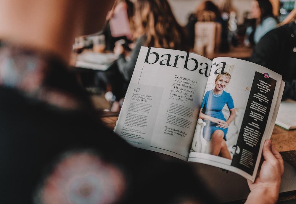 person reading Barbara magazine