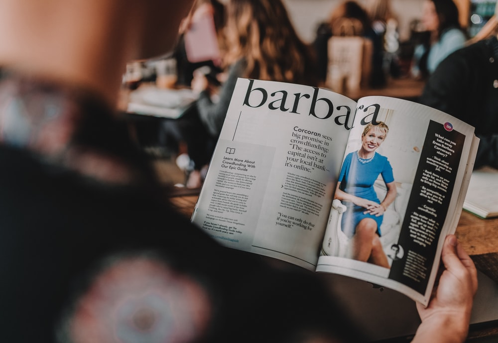person reading Barbara magazine