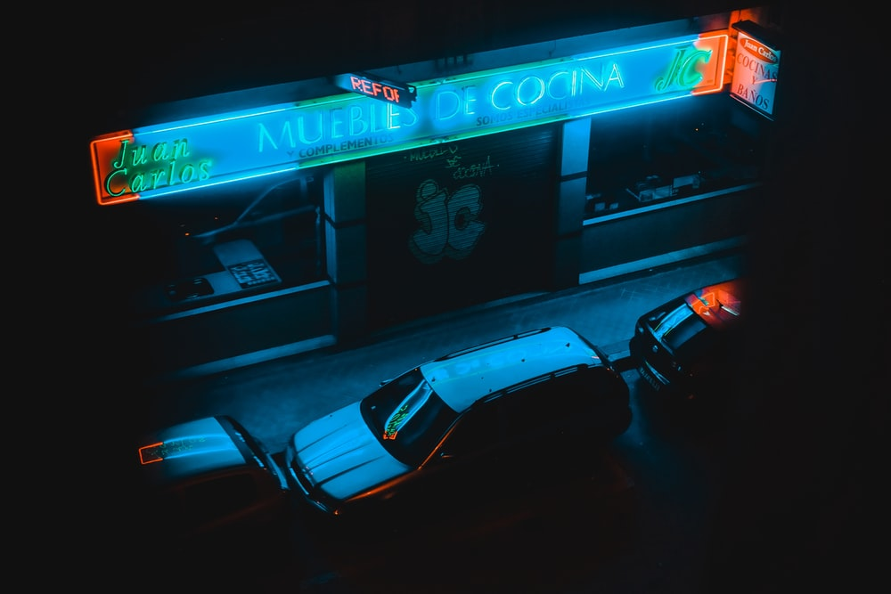 cars parked in front of cafe at night