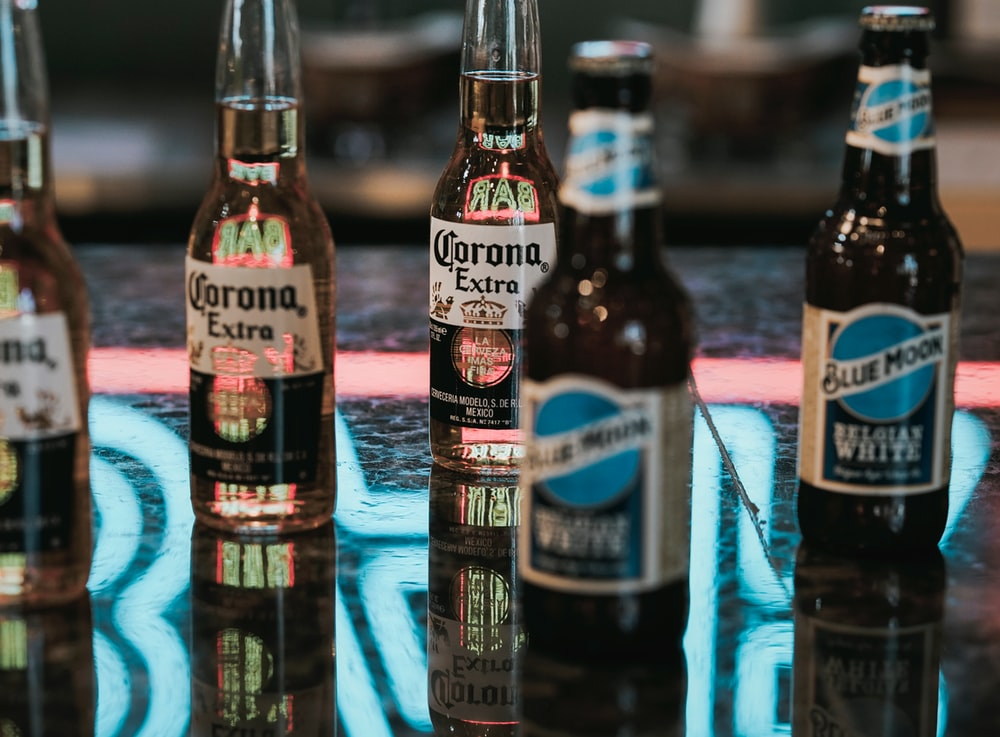 Corona Extra beer bottles on gray marble surface
