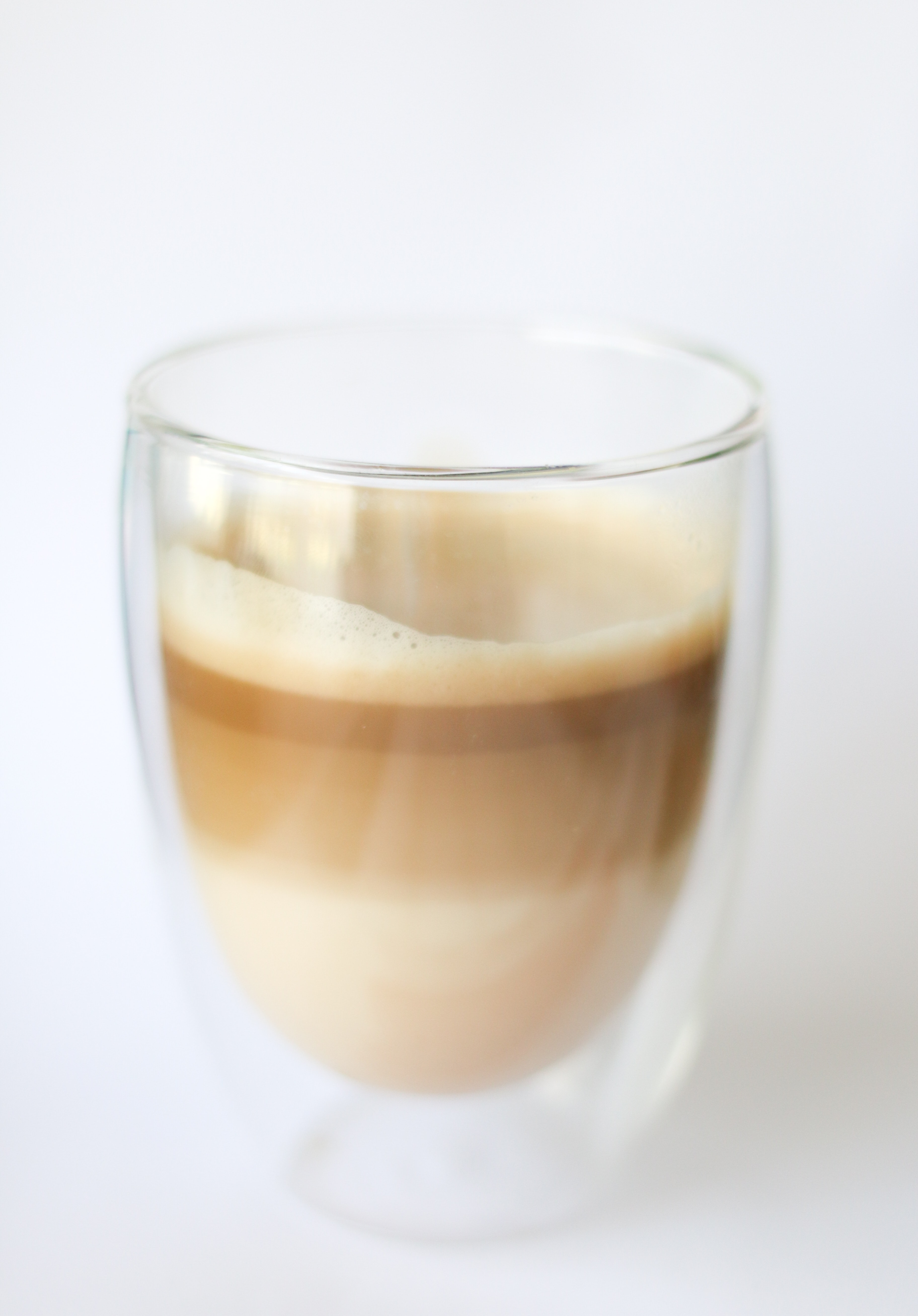 brown beverage in glass cup