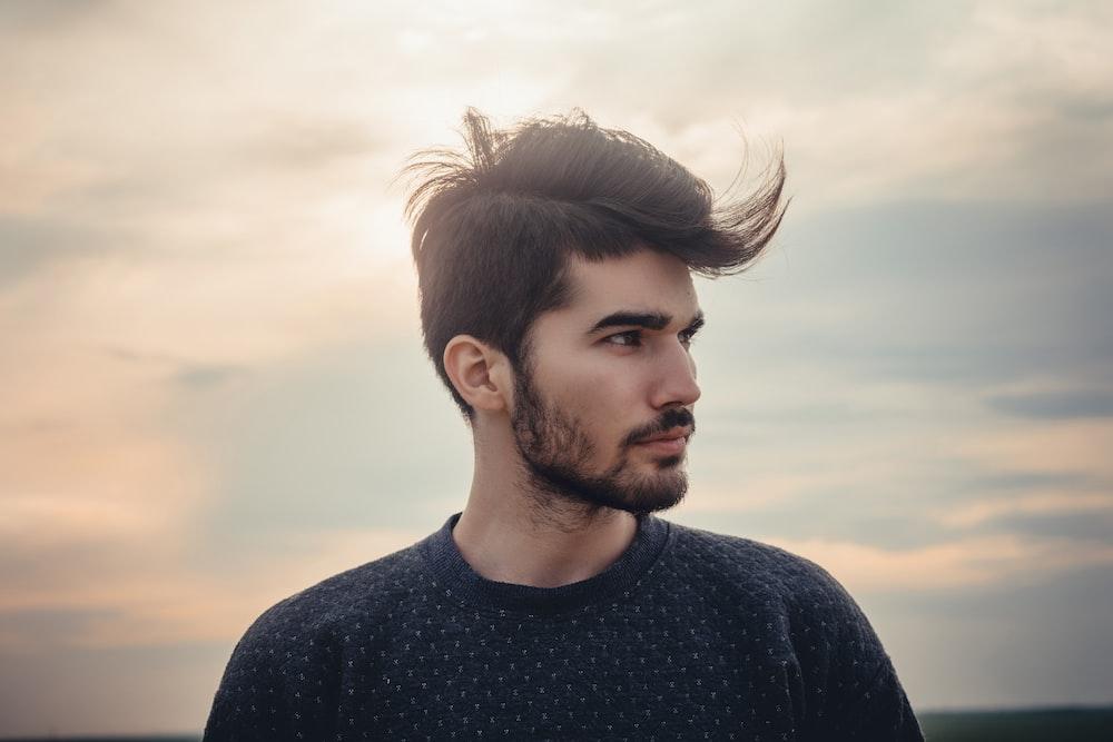 man wearing blue crew-neck top