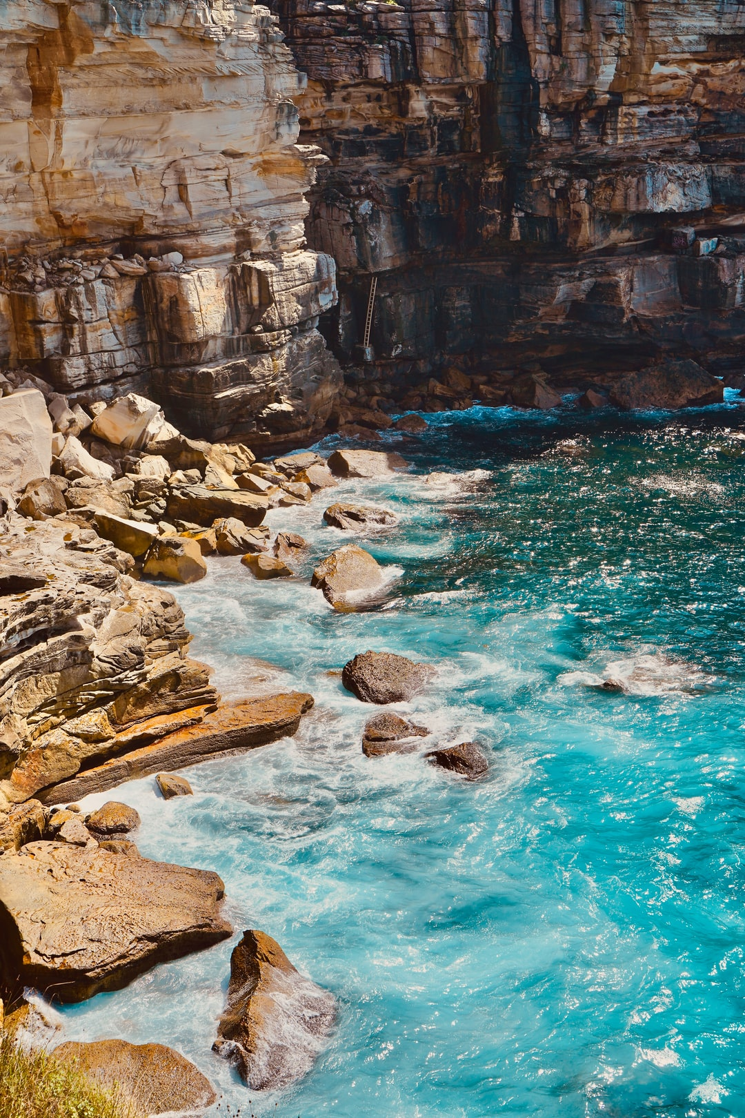 Blue Body Of Water Near Cliff Photo Free Nature Image On Unsplash