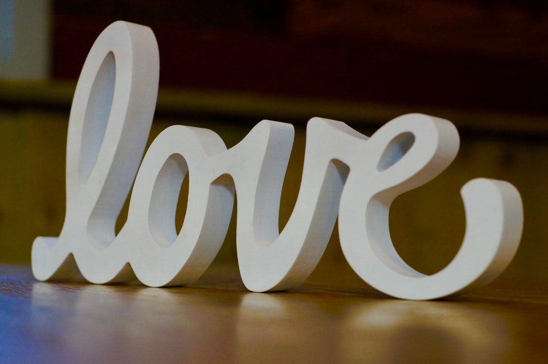 Wooden love carving at a wedding