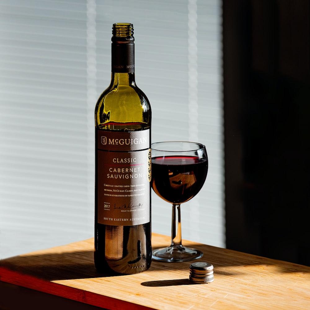 Cabernet Sauvignon wine bottle beside wine glass