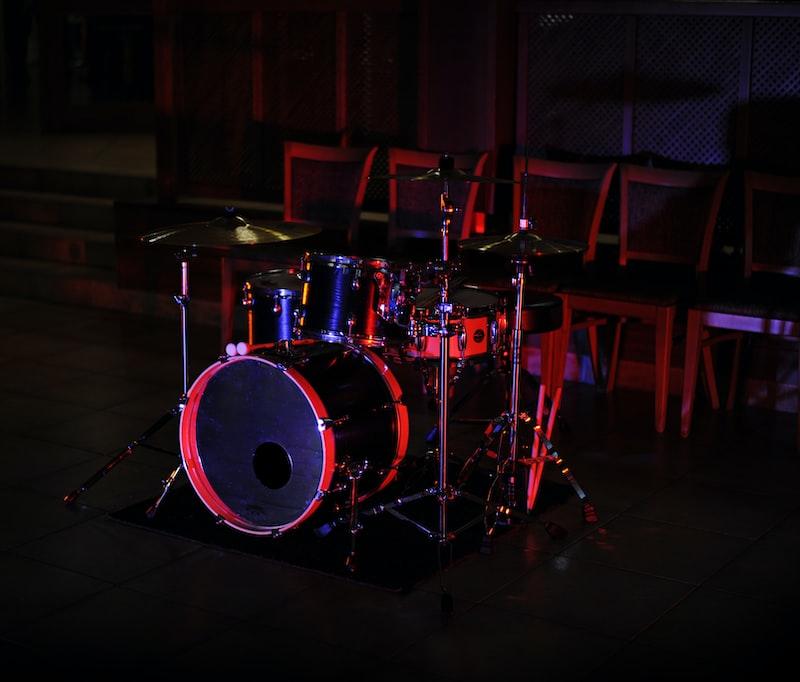 A dimly lit drum kit