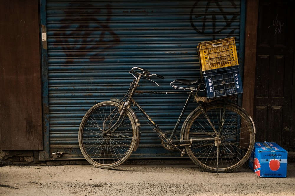 two crates on commuter bike parked beside roll-up door