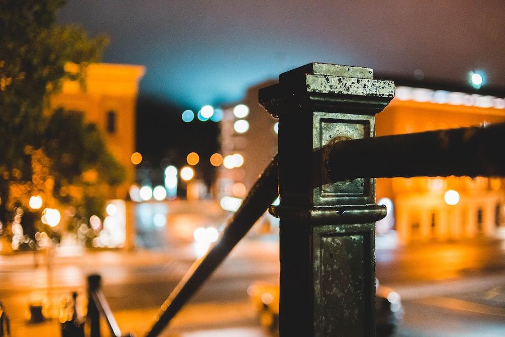 black metal railing at night