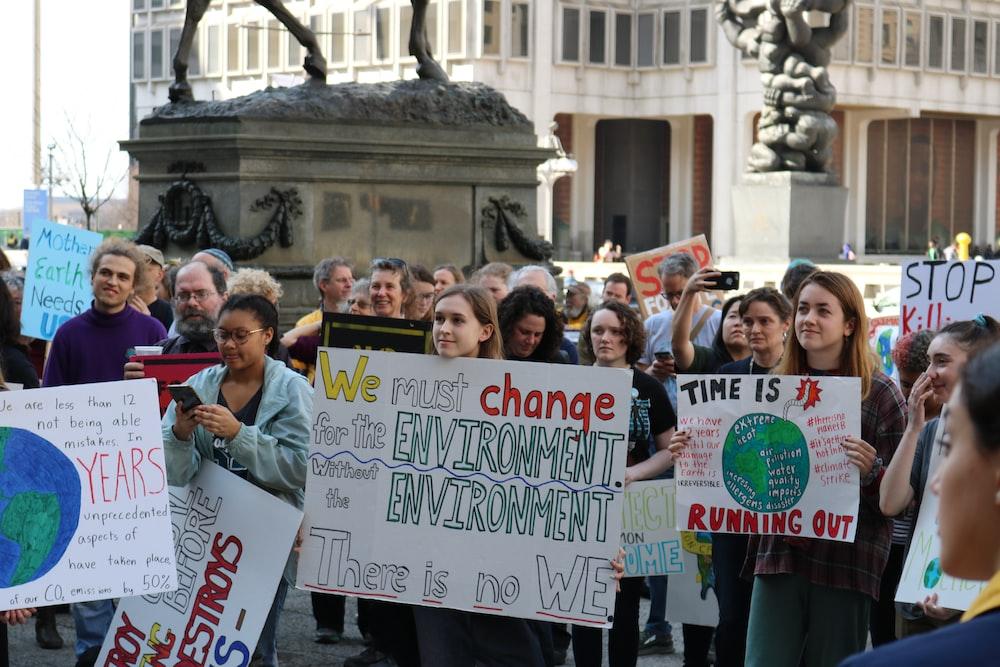 people gathering holding signage