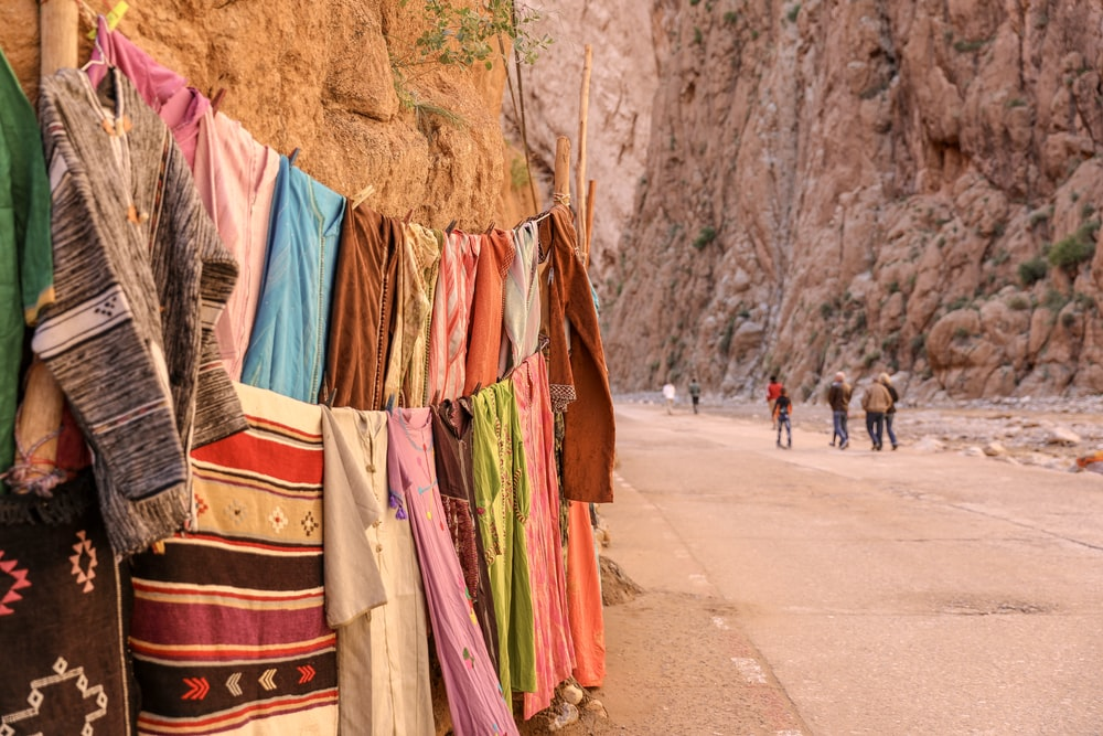 assorted clothes beside rock cliff