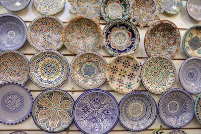 assorted color ceramic decorative plates lot art noveau teams background
