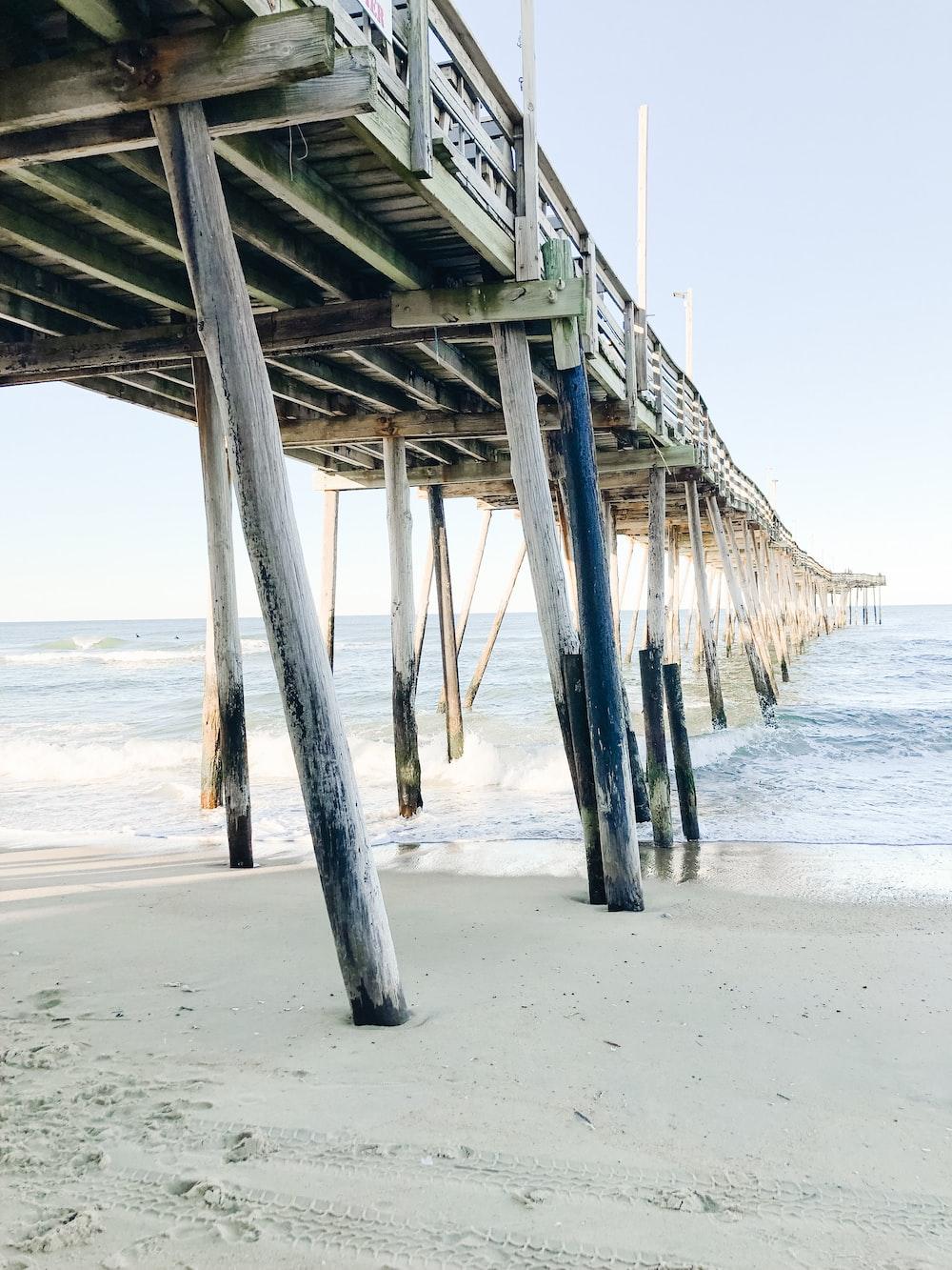 gray wooden bridge during daytime