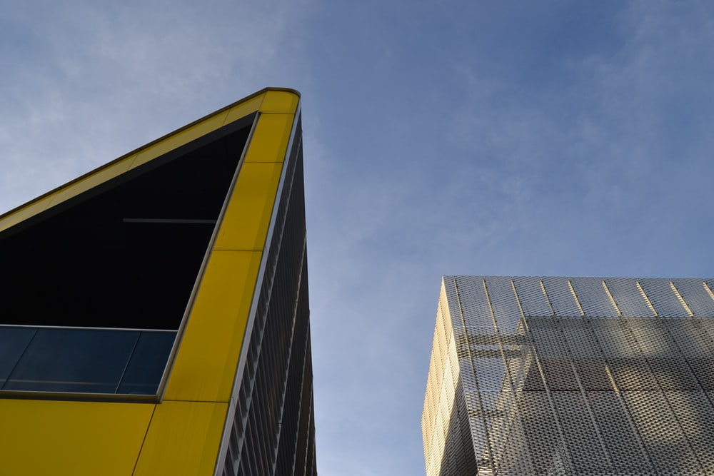 worm view photo of yellow and black building