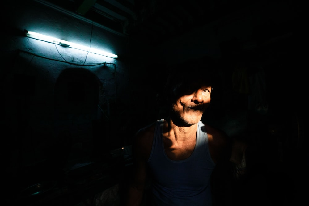man with face being hit by light