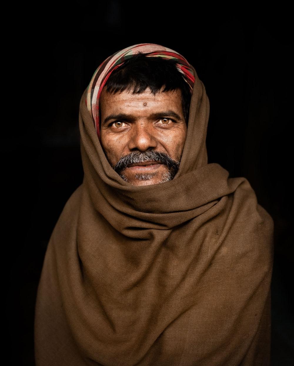 portrait of man wearing black hijab