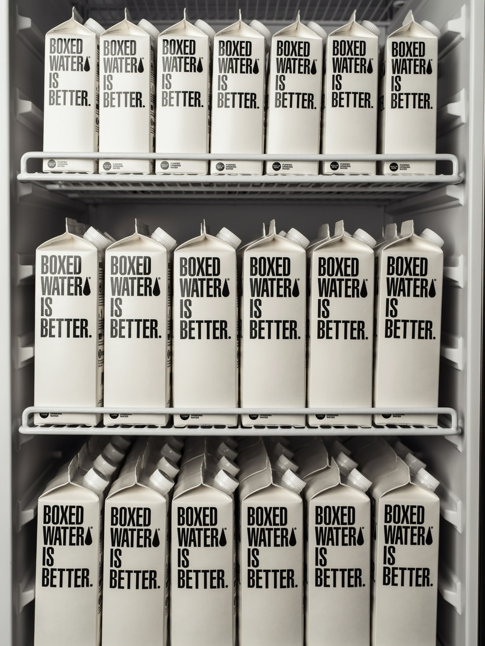 A water refrigerator full of Boxed Water cartons