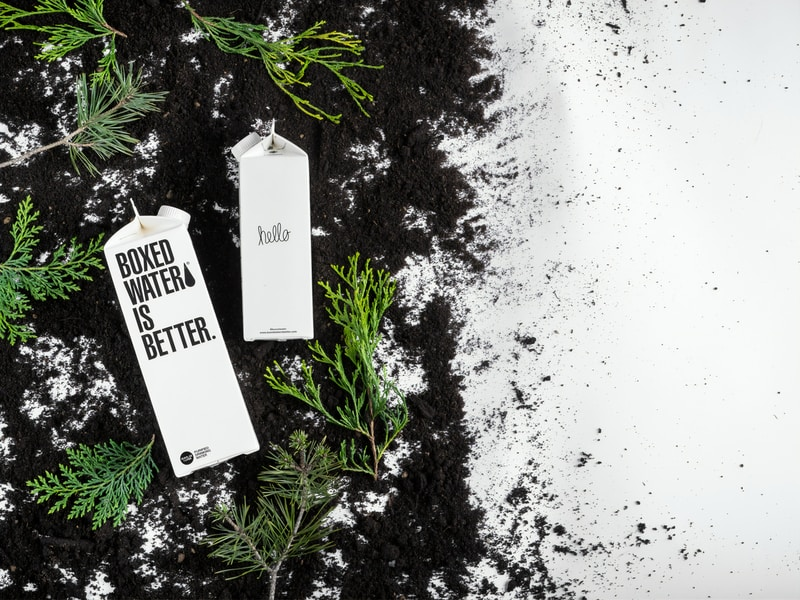 Boxed Water cartons on the black and white ground