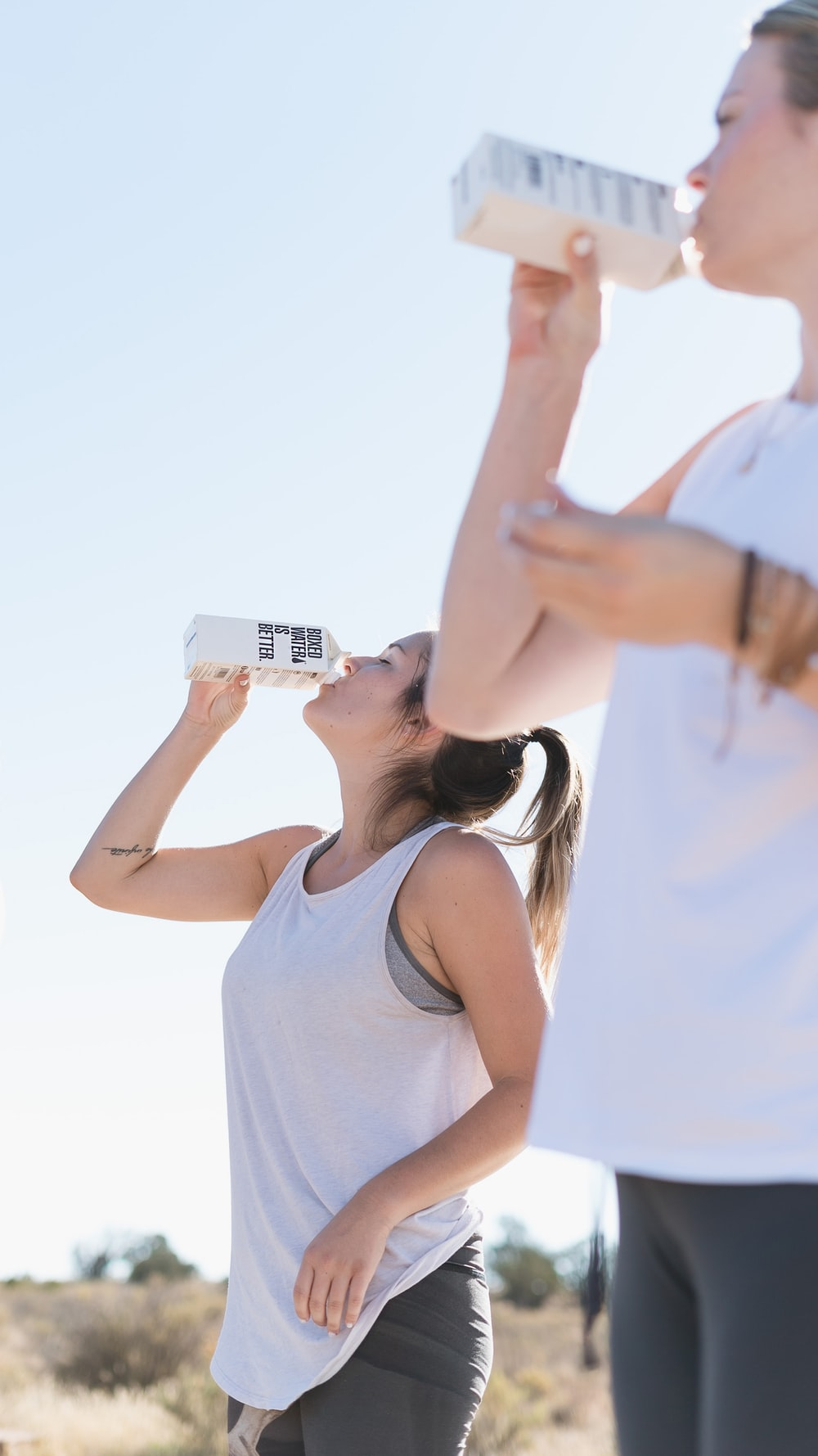 Two women working out and drinking Boxed Water