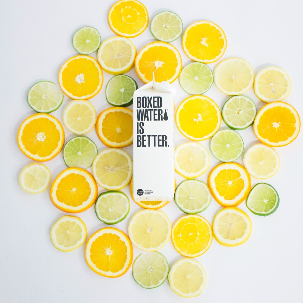 Sliced citrus fruits and a Boxed Water carton