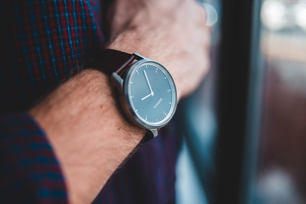 black analog watch reading 9:03