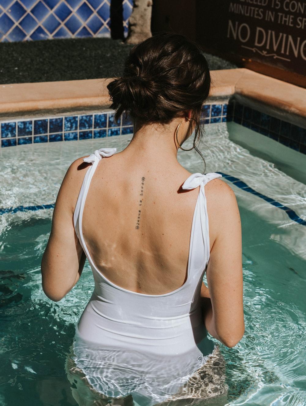 woman in white monokini in pool