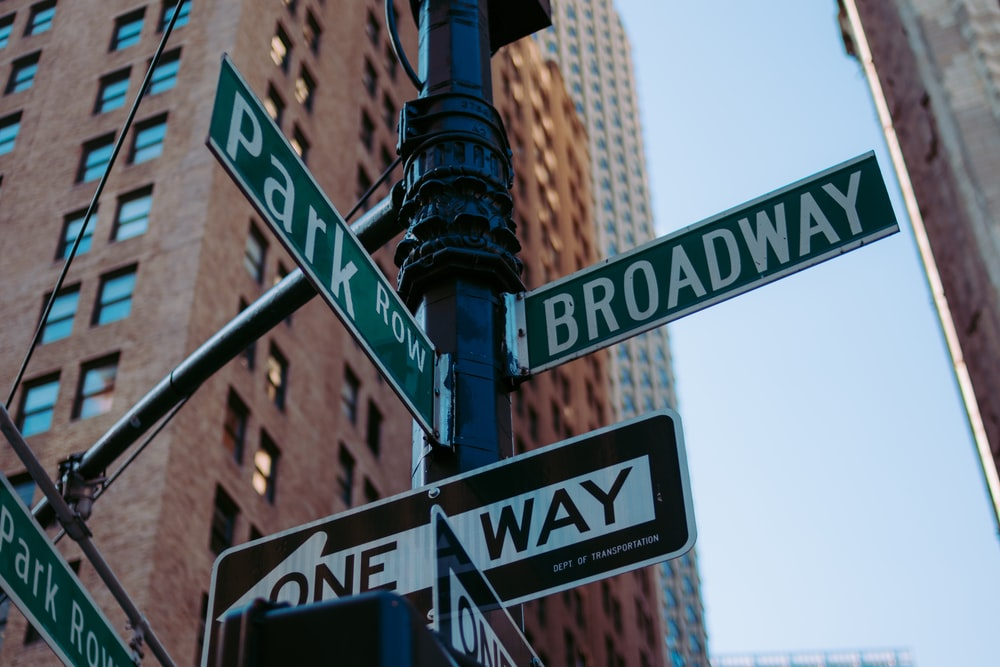 low-angle photography of street signage