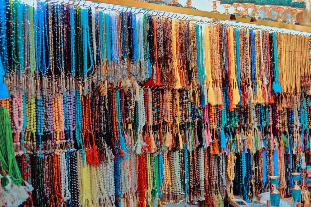 assorted-color prayer beads hanging on rack lot