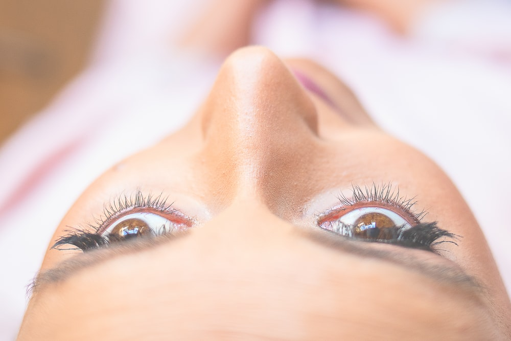 selective focus photography of woman eyes