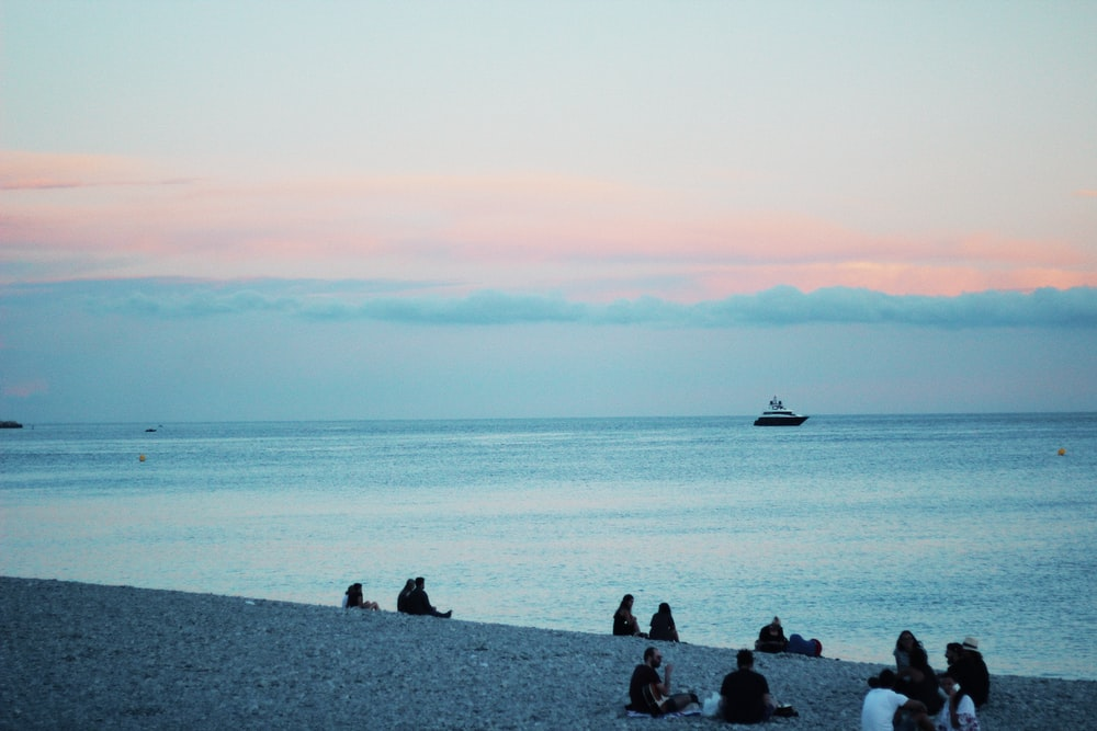 people sitting on shore
