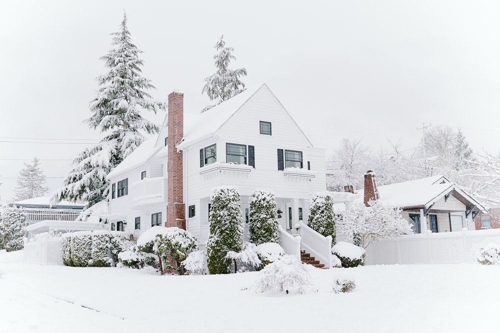 houses covered with snow during daytime
