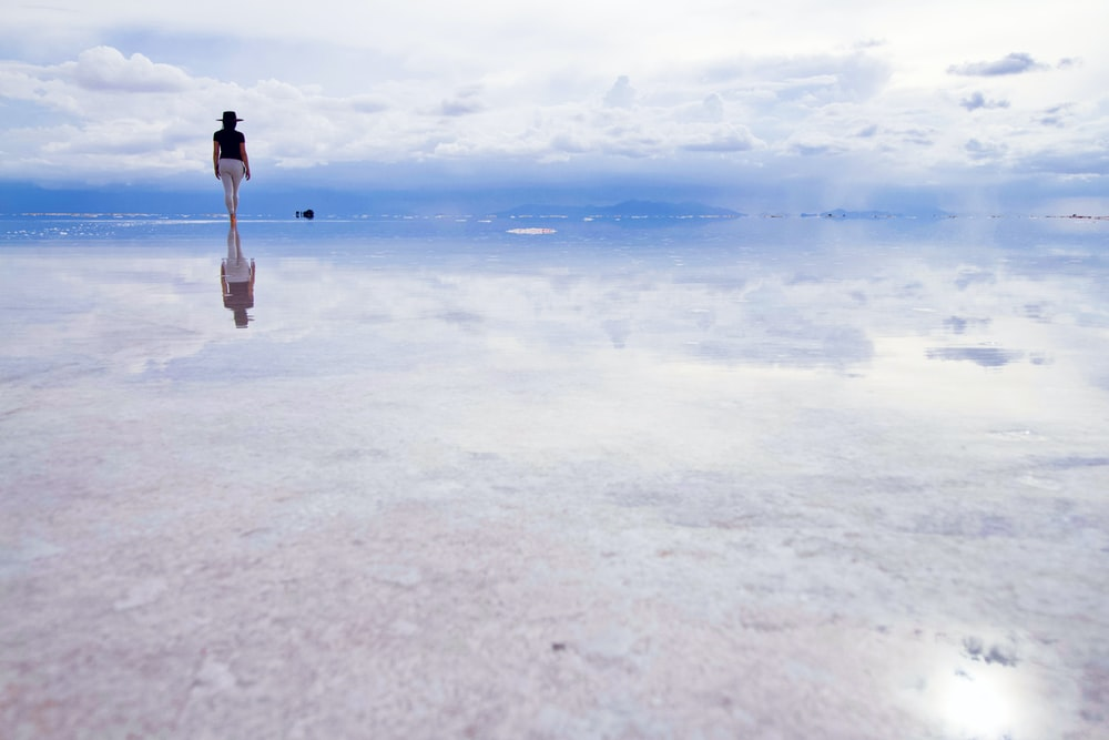 woman standing on water during daytime