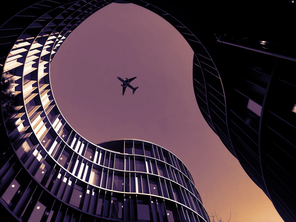 low angle photo of airliner in flight