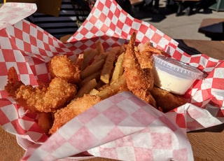 fried shrimp on white and red tray
