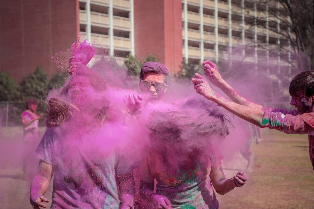 people in color spray festival