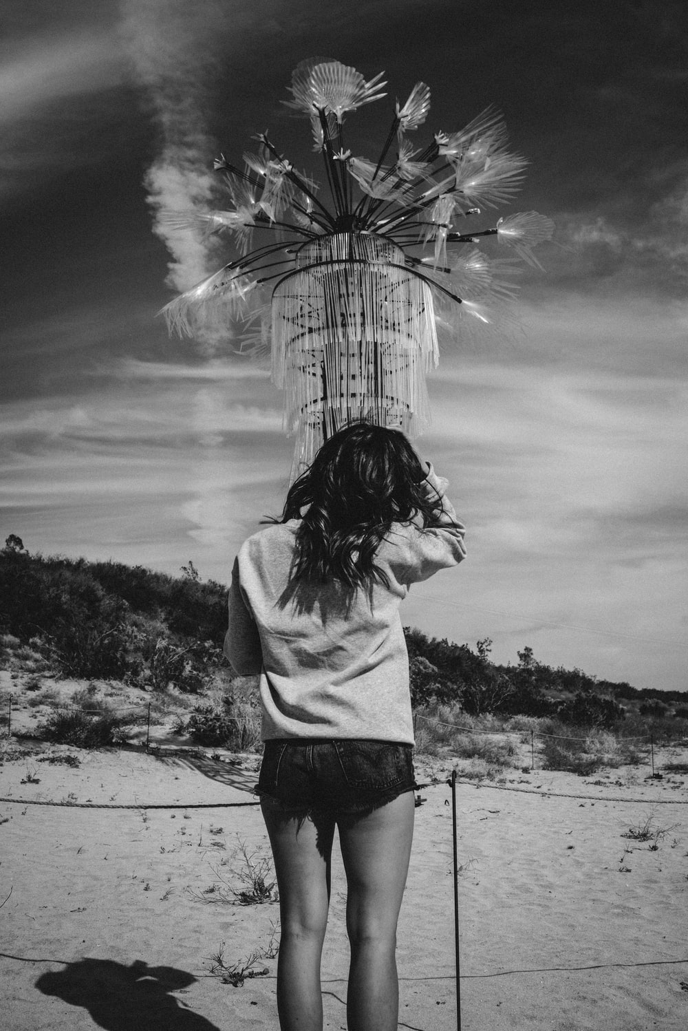 grayscale photography of standing woman