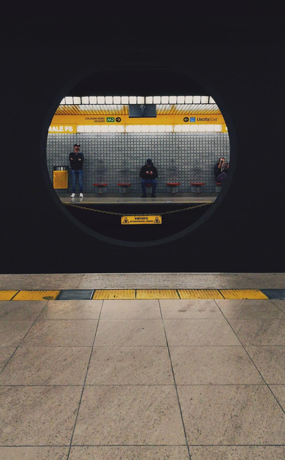 man sitting near man standing