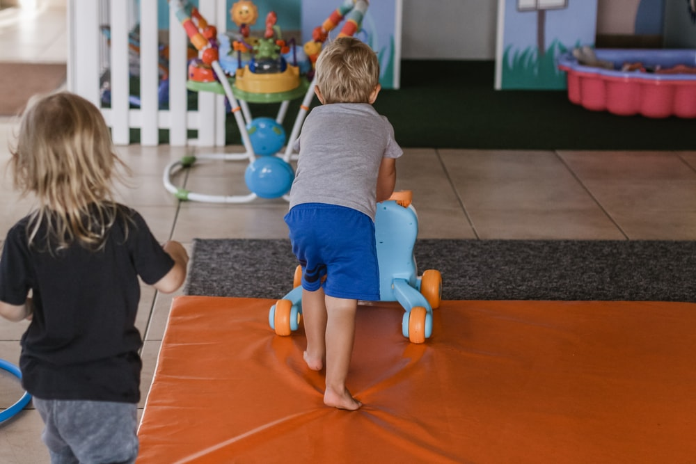 boy pushing push toy