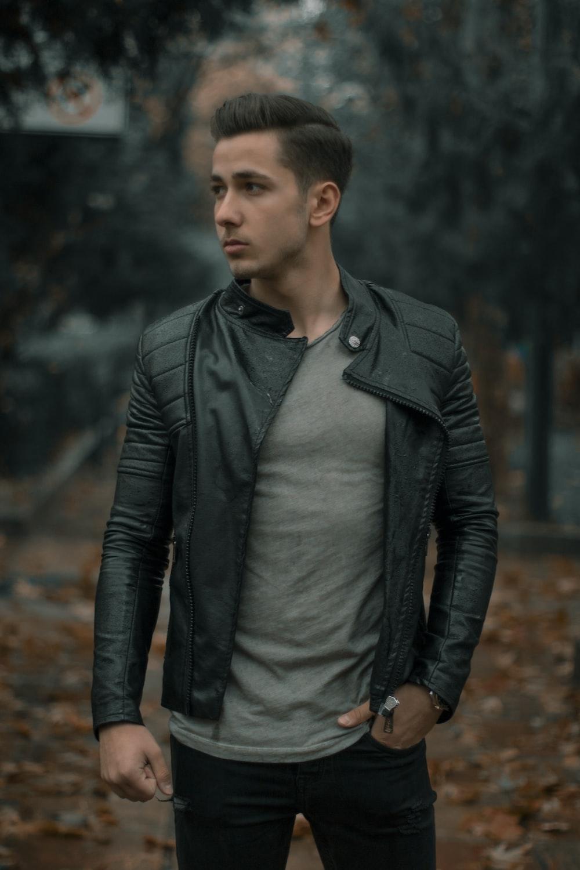man wearing black full-zip leather jacket photo