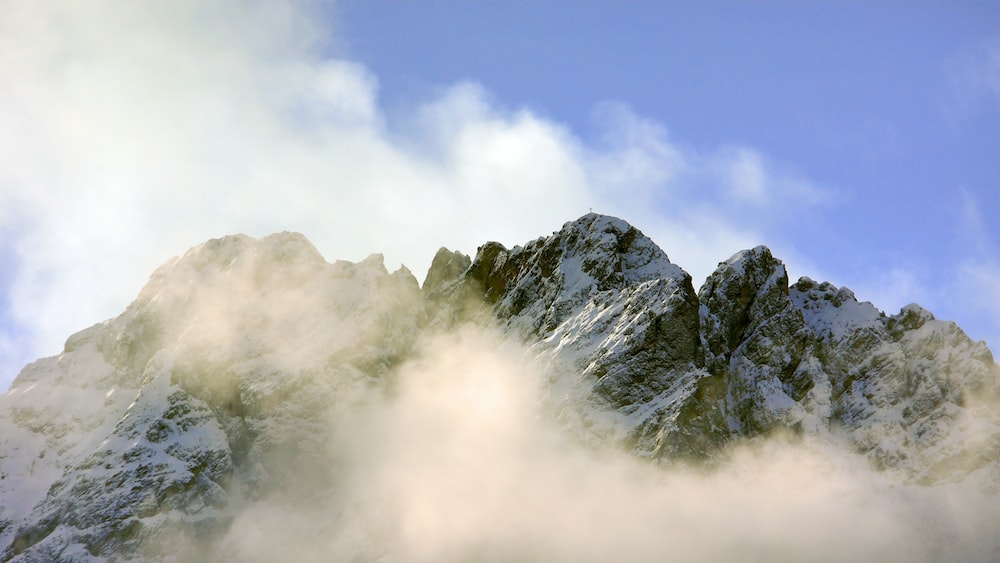 white clouds across mountain