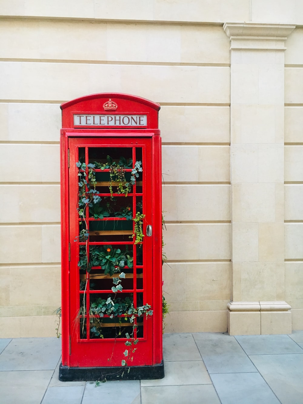 red telephone booth plat box